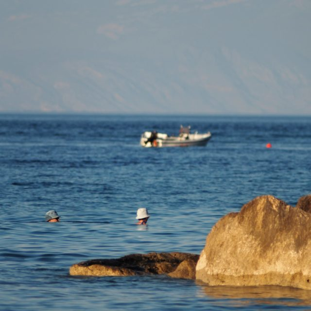 Aigeira - Swimmers near the rock pier - Aug 2018